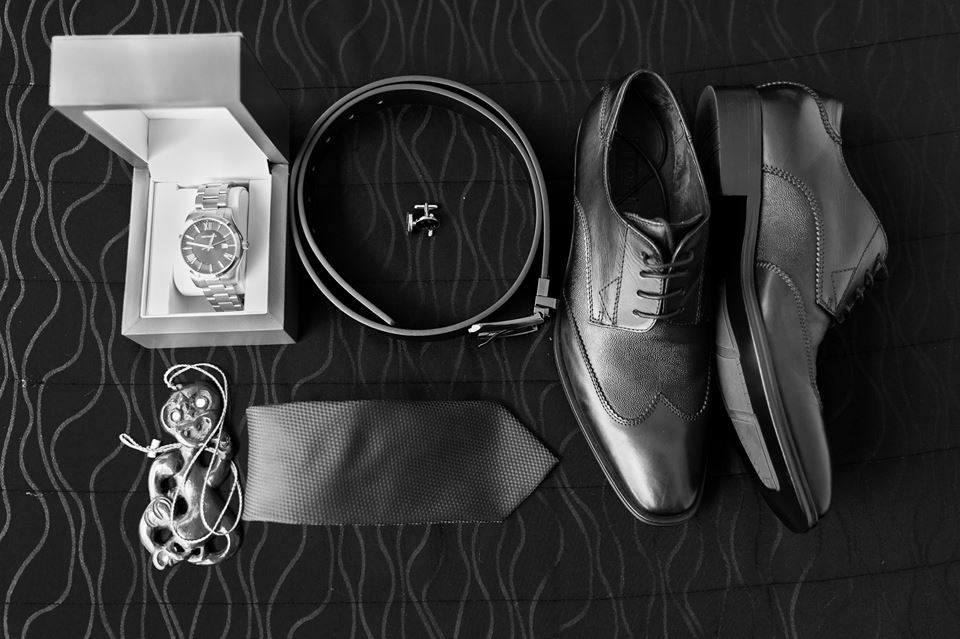 Birds+eye+view+of+grooms+shoes,+tie,+pounamu,+belt+and+watch