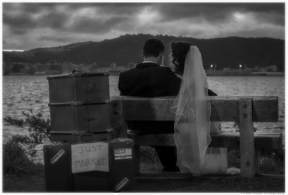 Bride+and+groom+sitting+on+a+park+bench+along+the+Wellington+waterfront