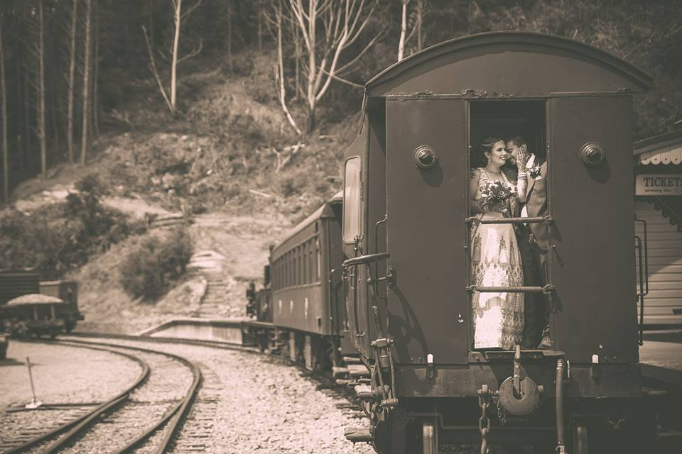 Bride+and+groom+standing+on+old+train+at+Silverstream+station