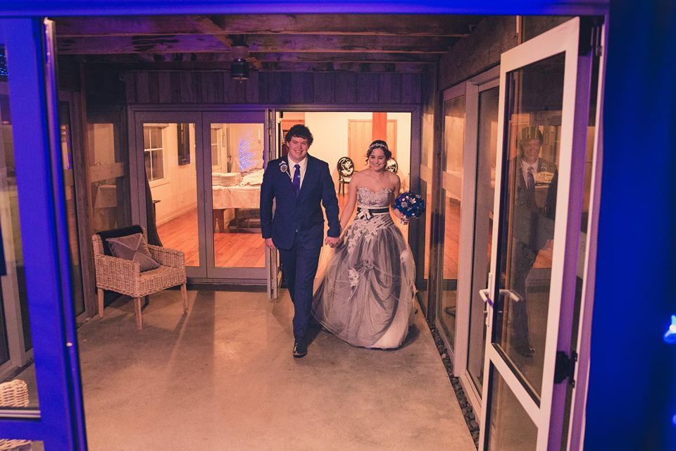 Bride+and+groom+walking+in+to+reception+together+holdig+hands