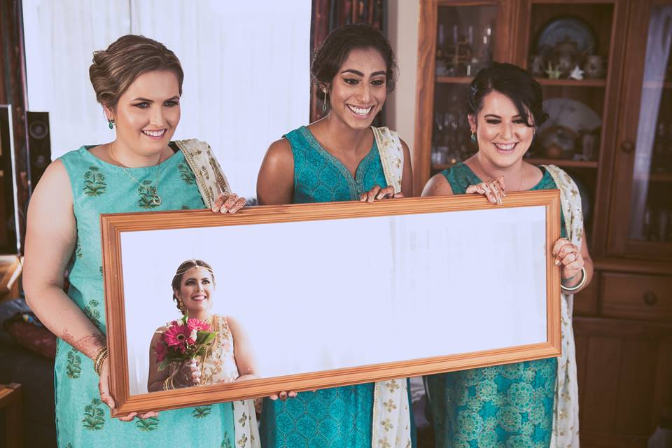 Bridesmaids+holding+a+mirror+showing+the+brides+reflection