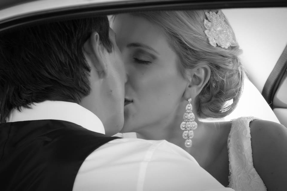 Close+up+of+bride+and+groom+kissing+in+the+wedding+car