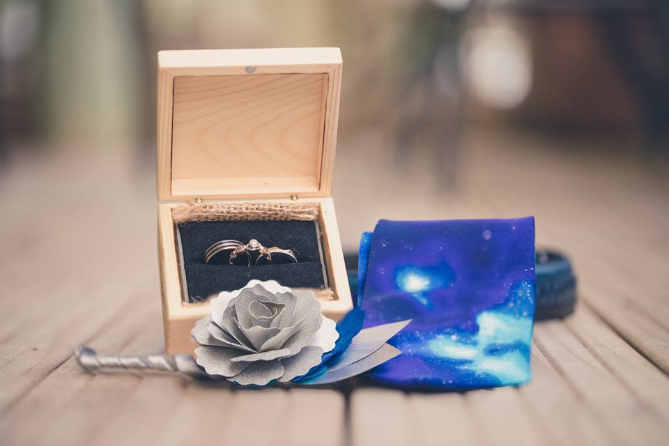 Close+up+of+ring+box,+blue+tie+and+silver+flower