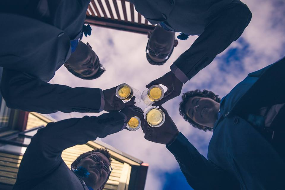 From+below+photo+of+groomsmen+standing+in+a+circle+holding+beers