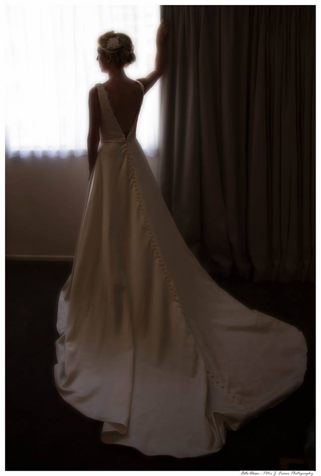 Full+length+photo+of+the+back+of+the+brides+wedding+dress