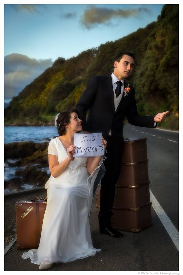 Just+married+bride+and+groom+on+the+side+of+the+road+trying+to+hitch+a+ride