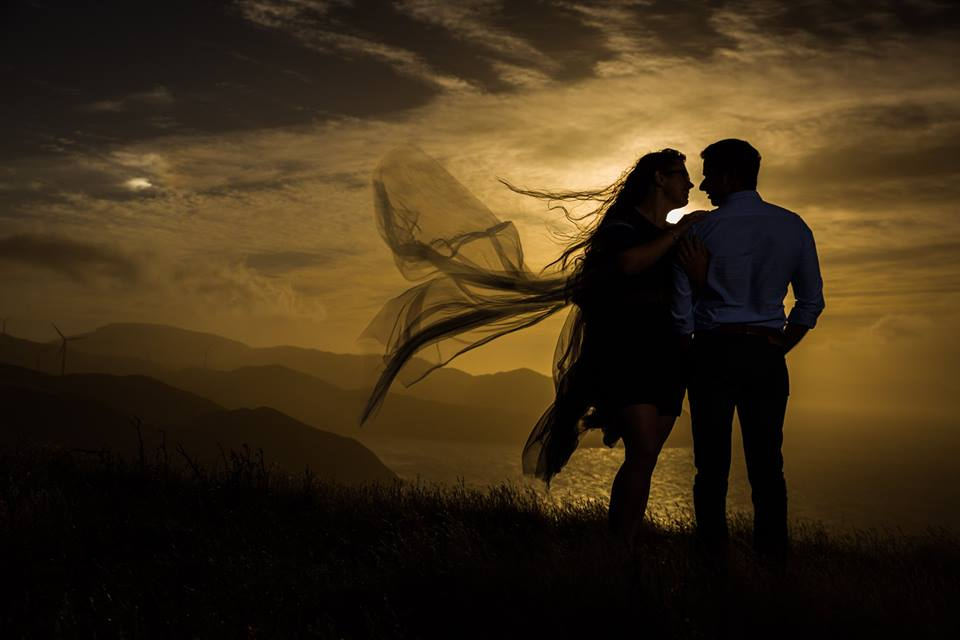 Silhouetted+bride+and+groom+against+yellow+sunset