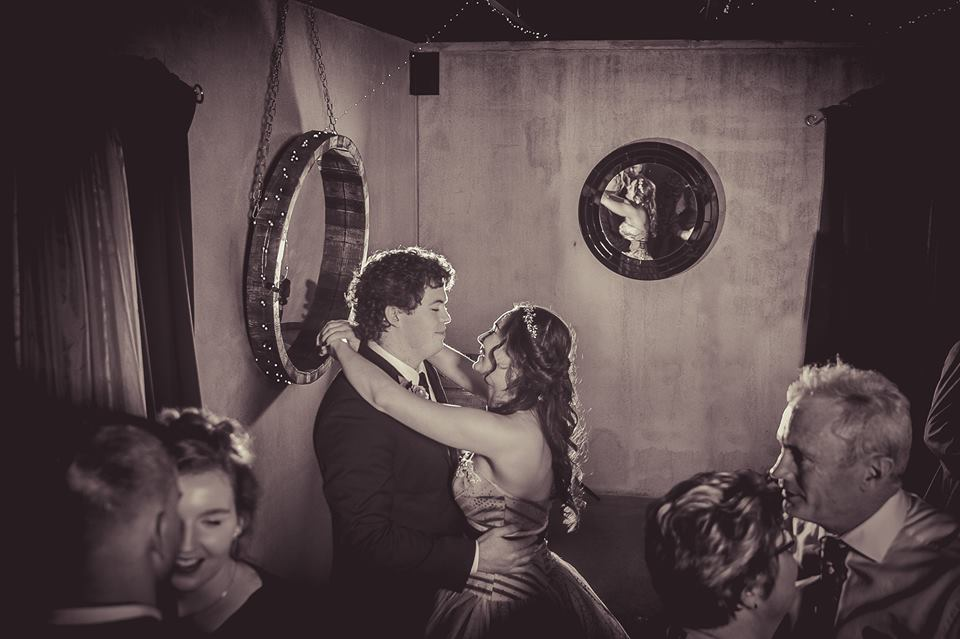 Waist+up+photo+of+bride+and+groom+dancing+togther+at+the+reception