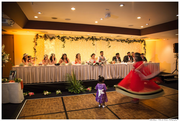 Bridal+party+at+reception+watching+traditional+indian+dancer