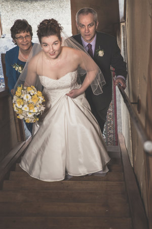 High+angle+photo+of+bride+walking+up+stairs+with+her+parents